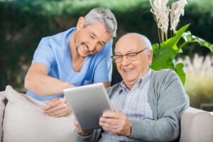 A Doctor explaining Home Health Services to an elder male.