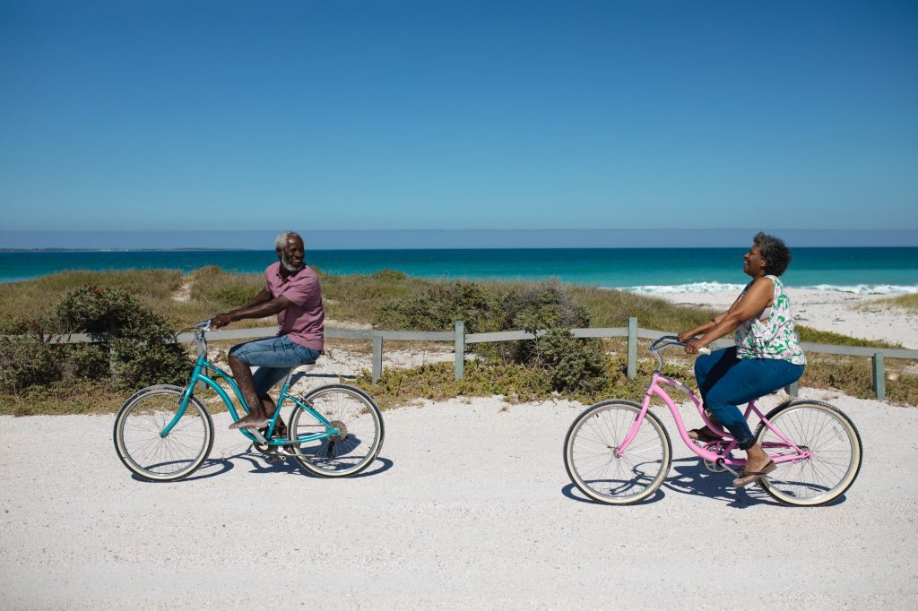 Old couple with bikes at the beach