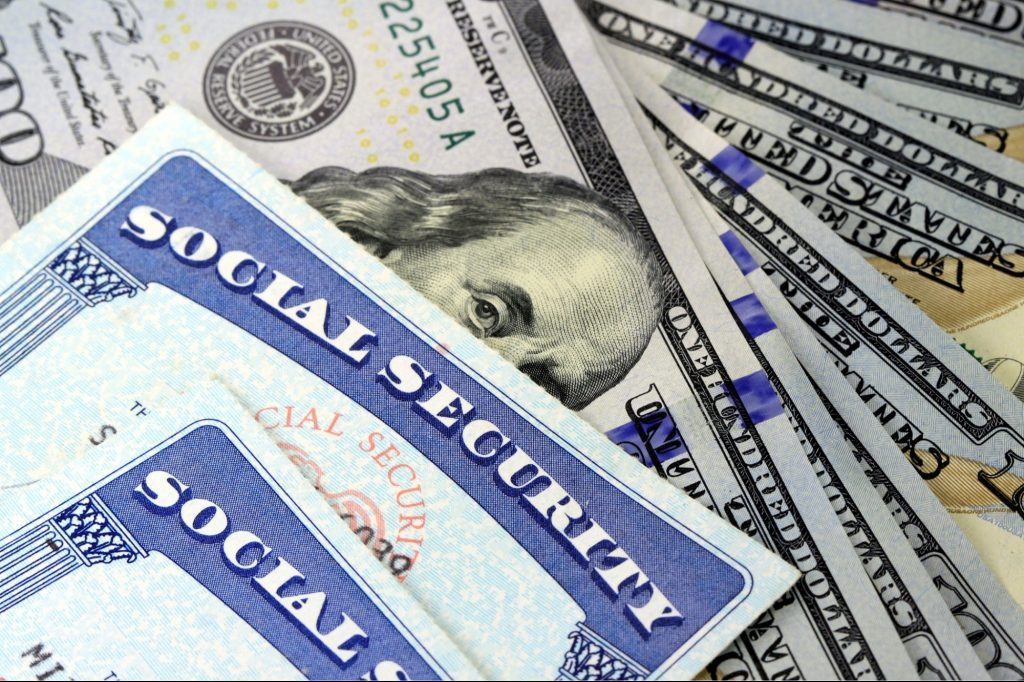Social Security Cards on top of Retirement Money