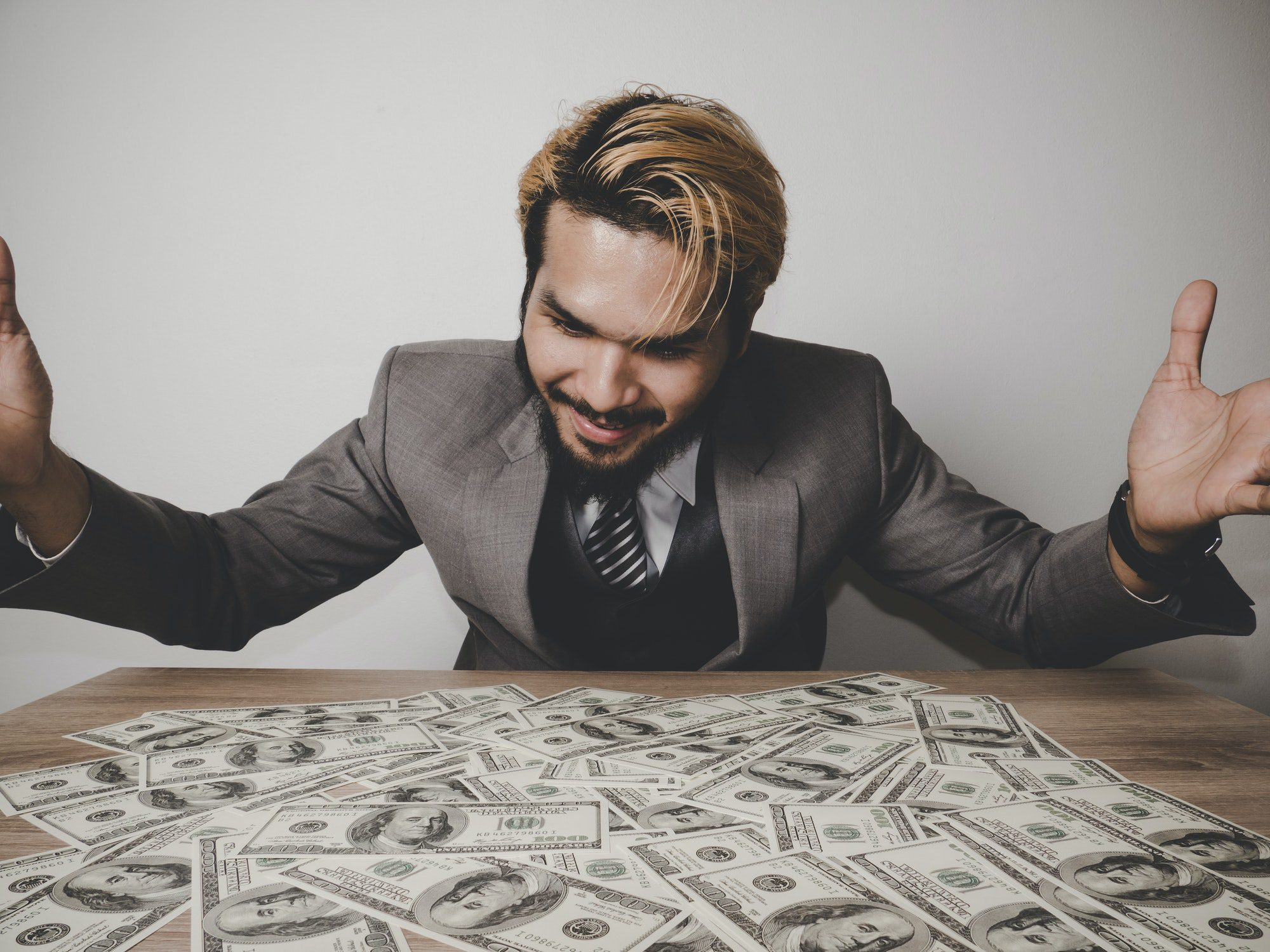 businessman happy with many dollar banknote, business success concept