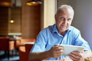 Senior man, researching Medicare Overcharge Measures