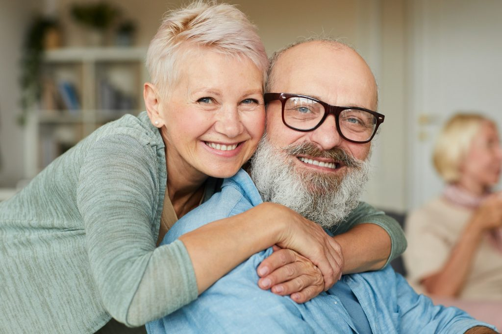 Happy senior couple enjoying aging in a community with others.