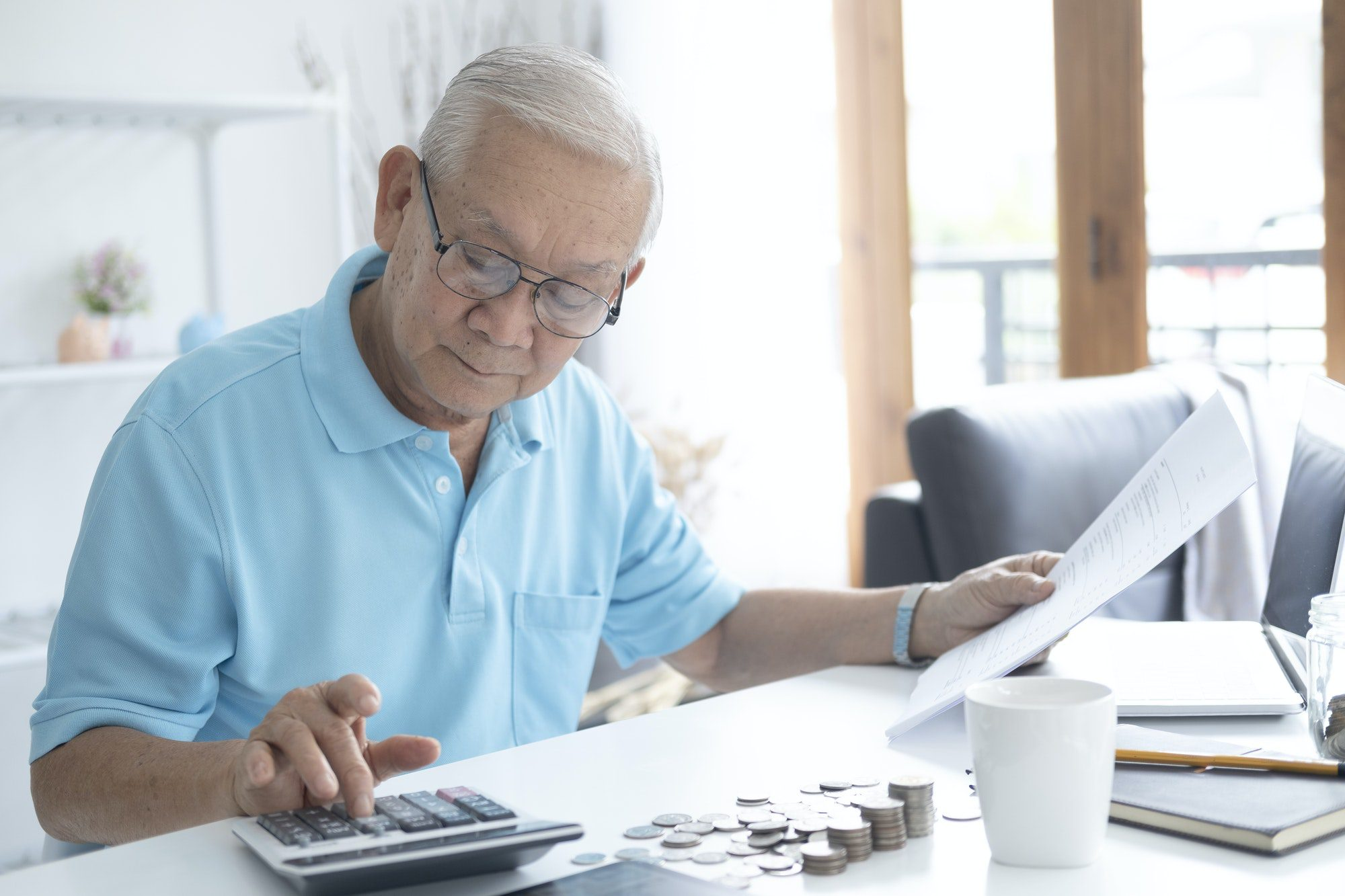 Senior man calculating how much to invest in Health Matching Account (HMA's).