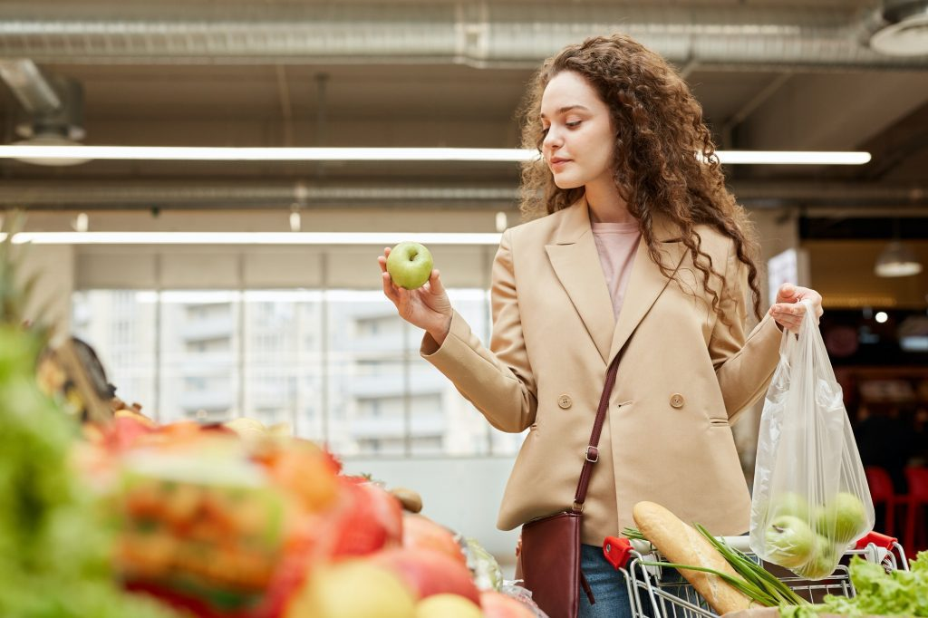 Young Woman Shopping in Grocery Store