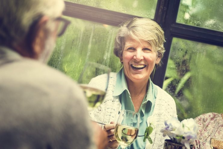 Group of Senior Adults at a Retirement Meet up being happy because they all are got there Medicare Advantage plans from the Texas Medicare Advisors