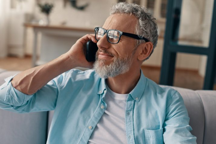 Senior man on the phone discussing his Social Security benefits