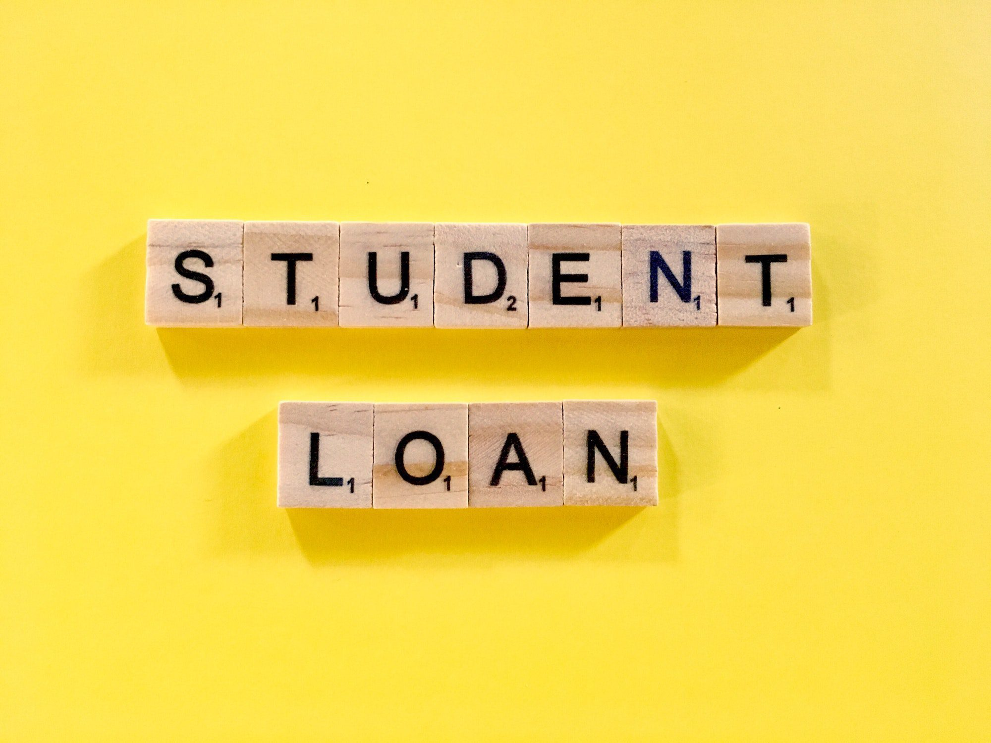 Blocks spelling student loan to show the lighter side of student loan debt for baby boomers.