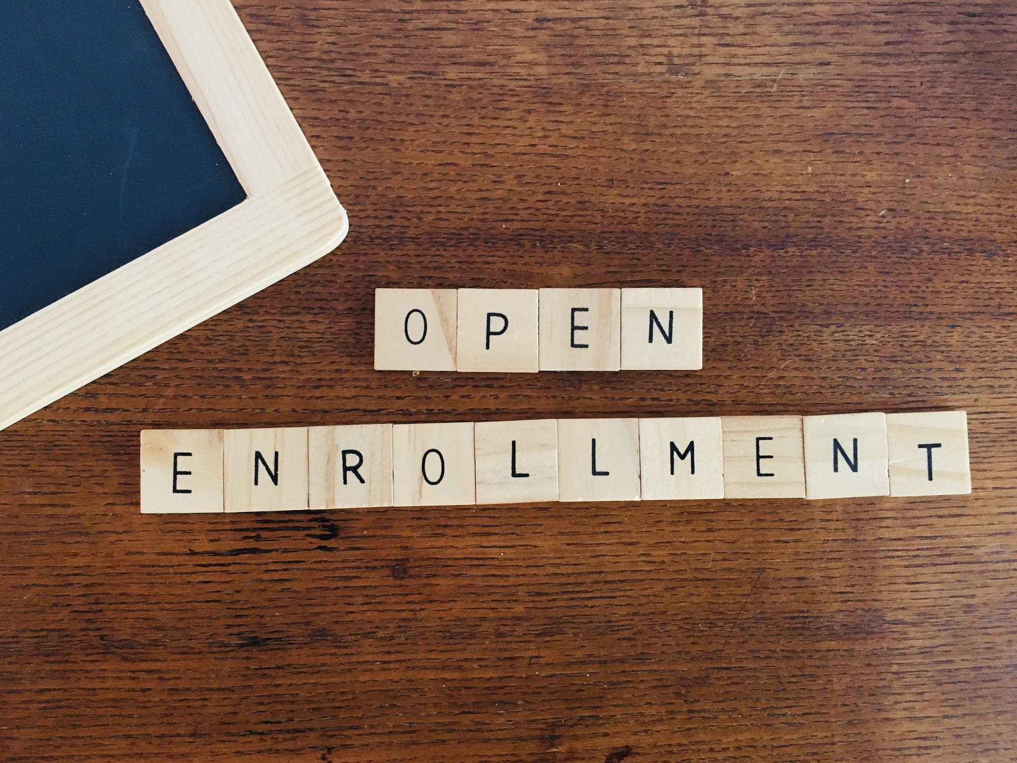 Open Enrollment spelled out with wooden tiles this is when you can join, switch, or drop a drug plan?